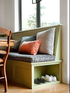 banquette offers a handy storage spot for shoes near the back door