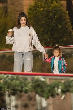 What a good aunt: Kendall's trademark brunette tresses were long and loose with a part in the middle