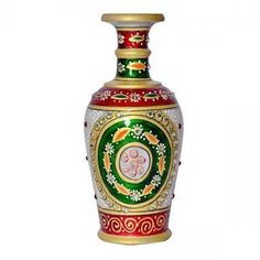 This marvelous flower vase crafted in pure white marble, it is embellished with Meenakari and kundan work that is complemented by expert enamelwork. Aesthetically designed Marble Flower Vase has been hand painted with gold paint with touches of Red and Green color for a graceful look.