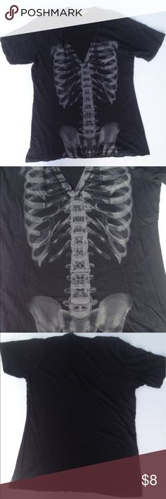 """Urban Outfitters The Beautiful Ones X-ray t-shirt Deep v-neck black tee screen-printed with cool X-ray image of ribs and hip bones that aligns on your torso! Gently used- has one small hole in back (see last pic). Size L and true to size. Approx. 22"""" long. Feel free to ask questions! the beautiful ones Tops Tees - Short Sleeve"""