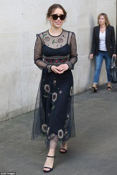 Another chic display: Emilia Clarke rocked a sunflower frock on Thursday as she hit BBC Ra...
