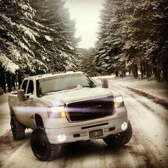 Beautiful white lifted GMC Sierra in Manitoba winter snow