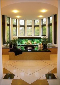 Aquarium Tub - Master Whirlpool with full accessibility. Custom sized fish tanks with motorized solar shades at the windows. Custom floor patterns using Silestone tile with Brass and Stainless divider strips.