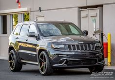 "2013 Jeep Grand Cherokee SRT-8 with 22"" Lexani R-4 in Black Milled (Concave Series) wheels"
