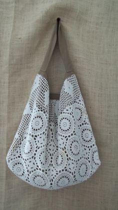 Bolsa de crochê com motivos redondos e filê