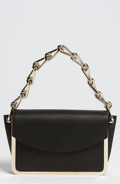 Reed Krakoff  'Anarchy' Leather Shoulder Bag -Details & Care Gleaming hardware outlines a sleek, compact shoulder bag cut from rich, pebbled-deerskin leather and topped with a chunky chain strap for a modern, sophisticated aesthetic.         Magnetic-snap flap closure.         Interior wall pocket.         Leather.         Imported.     Price: $1,490.00 USD VIEW MORE INFO HERE: http://www.designerhandbagspurses.net/designer-handbags-are-worth-the-splurge/