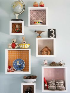 Wall-mount storage boxes with fun background.  I need to remember doing this to my drawer/shelves!