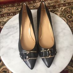 Black 9 west shoes Brand new. Never worn. Black leather nine west shoes. Very elegant. Dressy gold buckle at the toe of the shoe.  2 inch heel. Nine West Shoes Platforms