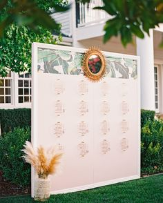 This wall hosted table assignments and a fun banana-leaf print. The assignments themselves were penned on slabs of hexagonal acrylic, then attached to the wall in brass standoffs. The bride cut out the gold-foil names herself, making a modern, glam display.