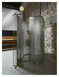The see through aluminium mesh screen was designed like a room-divider to create a cocoon of privacy. Wide-open or shielded, how much you reveal is up to you. Interior Design Blogs, Stone Interior, Lobby Interior, Screen Design, Cabinet Furniture, Furniture Design, Partition Screen, Decorative Screens, Rack Design