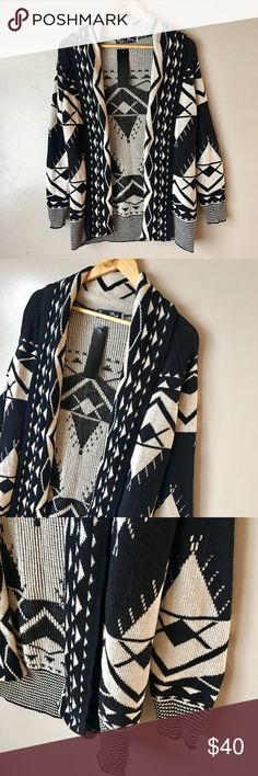 Only one left Aztec blue and white open cardigan This cardigan is thick and will keep you warm. Looks great with leggings or jeans. Open front cardigan. Excellent condition. No flaws. 50% cotton 50%. Size s/m. Boutique  Sweaters Cardigans