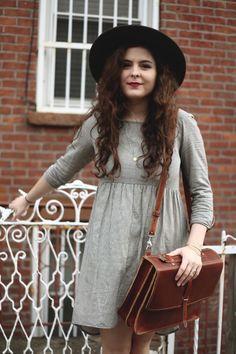 gray dress, satchel, black hat