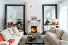 Get inspired by Eclectic Living Room Design photo by Chango & Co. Wayfair lets you find the designer products in the photo and get ideas from thousands of other Eclectic Living Room Design photos. Small Living Rooms, Small Living Room Design, Living Room Orange, Small House Decorating, Small Living Room Decor, Living Room Interior, Living Decor, Living Room Mirrors, Room Design