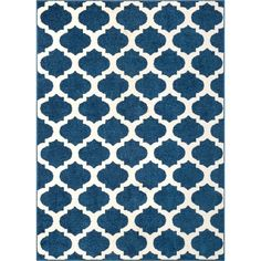 "Lend a pleasant pop of pattern to any ensemble with this denim blue area rug, showcasing a bold, Moroccan tile-inspired trellis motif. Made in Turkey, this rug is machine woven of stain- and fade-resistant polypropylene in a medium 0.4"" pile – perfect for rolling out in fashionable living rooms and dining spaces prone to the occasional spills and stains. Complete with a durable, hardwood floor-safe jute backing, this rug performs best when paired with a rug pad to prevent shifting and…"