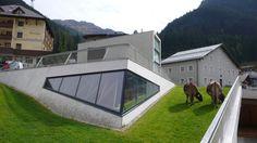 Kulturzentrum Ischgl is a green-roofed village center in Austr...