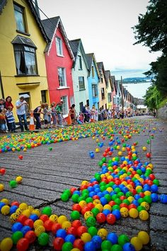 The Barrack Hill Ball Roll is a unique lottery in Cobh, Ireland. Thousands of colorful numbered balls cascade and bounce down West View lane.