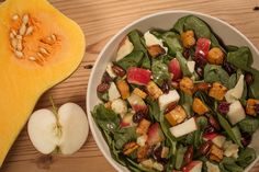Sweet squash, crunchy almonds, tangy white cheddar, juicy pomegranate seeds: our roasted butternut squash salad is a fall all-star. Squash Salad, White Cheddar, Roasted Butternut Squash, Pomegranate Seeds, Almonds, Kids Meals, Smoothies, Salads, Menu
