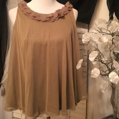 New Directions top Super cute top , it's asymmetrical and it goes lose , decorations in the top are adorable , 100% polyester new directions Tops Blouses