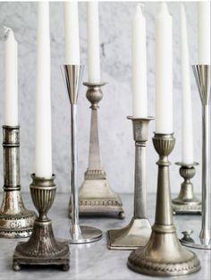 Vintage candlestick holders. Put inside tall glass votive