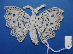 This bobbin lace butterfly is made in ecru linen and is probably French. Worked from side to side, mostly in cloth stitch with holes and veins, the edging to the wings is formed by crossing twisted pairs.  Dated as being from the early 20th century. Purchased from the collection of the late Shirley Burness-Smith. Catalogue: SBS.62.2011