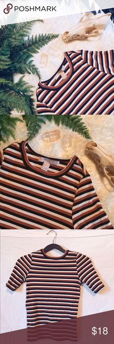 Body hugging striped top Nice 70's feel to this shirt. It's not a crop but it's not full length either. Dark brown, burnt orange and cream stripes. Rubbed fabric. Worn a few times. Forever 21 Tops Crop Tops