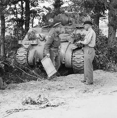 General Roberts, commanding 11th Armoured Division, with Brigadier Roscoe Harvey of 29th Armoured Brigade, and a Sherman command tank, 15 august 1944.
