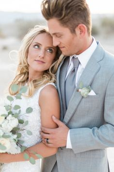 Light grey suit with a succulent boutonniere is such a great combination. Photography: Poiema Photography http://brooke-borough.com/