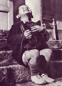 Boy receiving a new pair of shoes at an orphanage in Austria, 1946