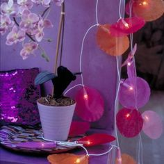 Guirlande lumineuse habillée de tissu rose et orange