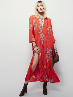 Rosemary Dress | This gorgeous long sleeve sheer maxi dress features an allover floral print and a high empire waist.  Low V-neck with tie detailing and a high slit on the skirt.