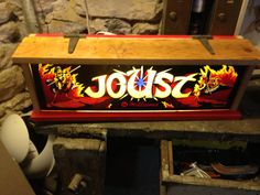 Lightbox made from original Joust arcade game marquee.