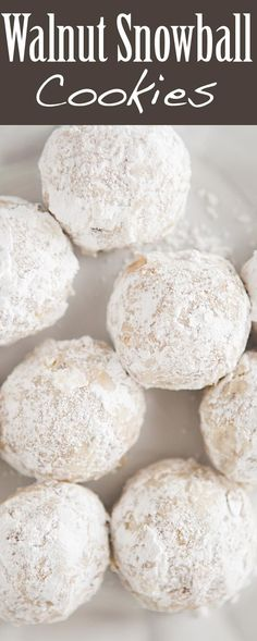 Festive holiday snowball cookies! made with finely chopped walnuts, flour and vanilla, rolled into balls and dusted with powdered sugar.