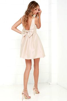 You've been eyeing the Bow Me a Kiss Beige Backless Dress long enough, it's time…