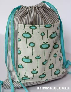 Use a favorite fabric to make a DIY-drawstring-backpack as a back to school bag for your favorite little.