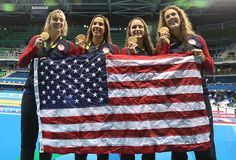 #RIO2016 Katie Ledecky Maya Dirado Leah Smith and Allison Schimdt of United States pose with their Gold medals from the Women's 4 x 20m Freestyle Relay on Day...