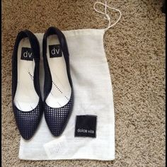 Dolce vita perforated pumps Worn 3x. Super cute on. Wear on the sole and tips. 3rd pic shows creasing on the back of the left shoe. Dolce Vita Shoes Heels