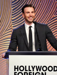 Chris Evans Photos Photos - Actor Chris Evans speaks onstage at the Hollywood Foreign Press Association's Grants Banquet at The Beverly Hilton Hotel on August 14, 2014 in Beverly Hills, California. - Hollywood Foreign Press Association's Grants Banquet Show