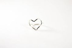 This darling heart ring is made of 16 gauge wire in your choice of Sterling Silver, 14k Gold Fill or Rose Gold Fill. Once the ring is formed it is then hammered lightly and polished for added dimension and shine. All White Sand Jewelry comes in a hand stamped gift box ready for gifting. U.S. ring sizes available in the drop down menu.  NOTE: This listing is for ONE ring only.  PROCESSING TIME: Each piece is handcrafted and made-to-order, specifically for you. Although I do my very best to…