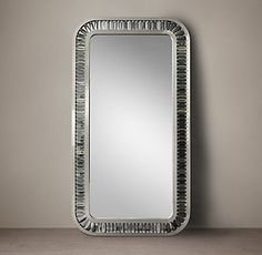 RH's Lombard Prism Leaner Mirror:This glamorous mirror takes inspiration from the luxurious lines and Machine-Age materials of Art Deco, a style born in 1920s Paris. Set within a frame of welded iron, dozens of close-set, optical-quality prisms create endlessly shifting sparkle.