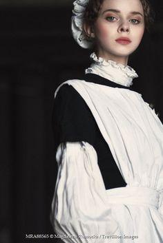 Nora, Maggie's maid