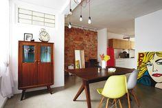 brick wall.  white space.  retro furniture.