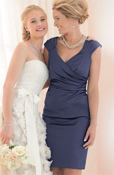 navy blue mother-of-the-bride dress.like her up-do too.the wedding dress is very sweet for a young bride.for mom, this color is perfect! Mother Of Groom Dresses, Bride Groom Dress, Mothers Dresses, Mother Of The Bride Dresses Knee Length, Mob Dresses, Short Dresses, Summer Dresses, Beach Dresses, Evening Dresses