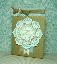 handmade birthday card ... lovely medallion effect using Floral Framelits dies and Daydream Medallion stamps ... cut little fish tail ribbons hanging ... olive, aqua and cream ... lovely!! ... Stampin' Up!