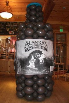 11 feet tall standing bottle. Can be made in many different colors. Our client provided their logo for the bottle. Designed by Balloons by Night Moods in Juneau, Alaska. www.juneausbestballoons.com