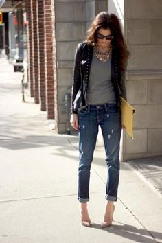 dress up your boyfriend jeans with a statement necklace, leather jacket, and pretty heels