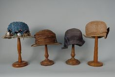 600 FOUR CLOCHES, 1920s One brown silk with straw braid and horsehair flower. One blue woven horsehair. One blue raffia with velvet flowers, Jereissati label. One tan net with swirls and brown velvet bow. Raffia hat lining poor, hats good-excellent. $345.00