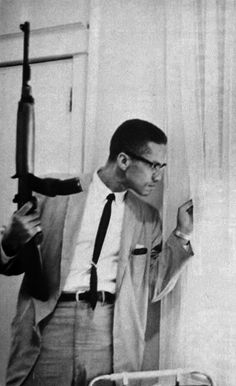 famous photograph that was in life magazine in march of 1964 and again in ebony in september of that same year in the picture malcolm x is holding a