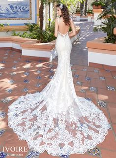 Kitty Chen never disappoints! The train on this dress is stunning and the low back makes this dress any bride's dream! Follow us @mycouturebridal to see more