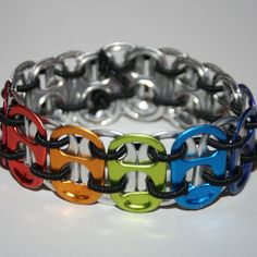 Rainbow Chakra Stretchy Pop Can Tab Bracelet - An awesome pop can tab bracelet made with colored drink tabs and black stretchy string! The colors correspond to the 7 chakras of the body.