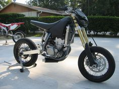 A motard-fighter hybrid. Get me one for Christmas. I'll be good, I promise!